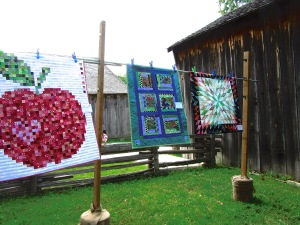 Quilts on display outdoors at Black Creek Pioneer Village