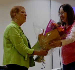 Kay Phillips receives a bouquet of flowers from guild president Anne McLauchlan