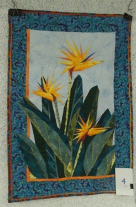 quilted wall art composed of Bird of Paradise flowers