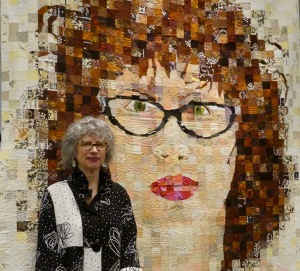 Sandra Bruce pictured with her Self Portrait quilt